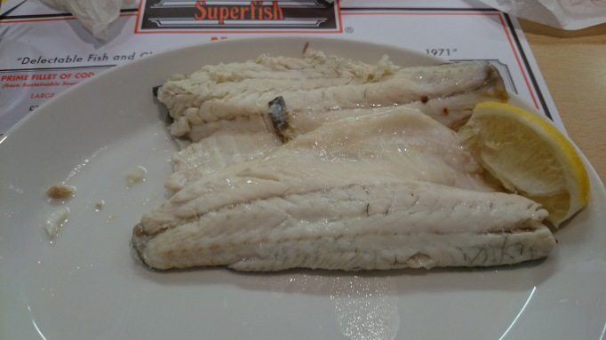 Seabass poached in white wine sauce