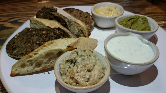 Henry's Grill bread and dips hommous, sour cream, guacamole and baba ganouche