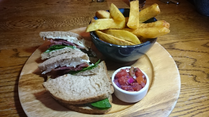 Three Horseshoes Laleham bacon and brie sandwich with chips