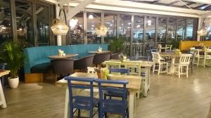 Garson's Farm Restaurant inside dining area with sliding glass doors to fields